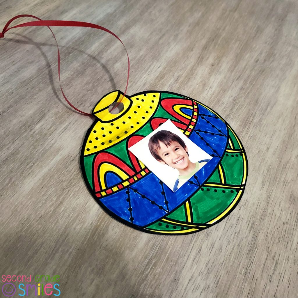 simple holiday ornament made by smiling student