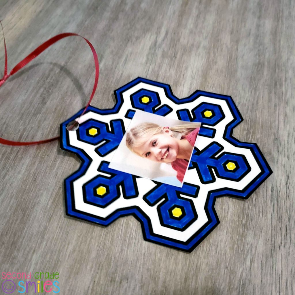 simple snowflake ornament made by smiling student