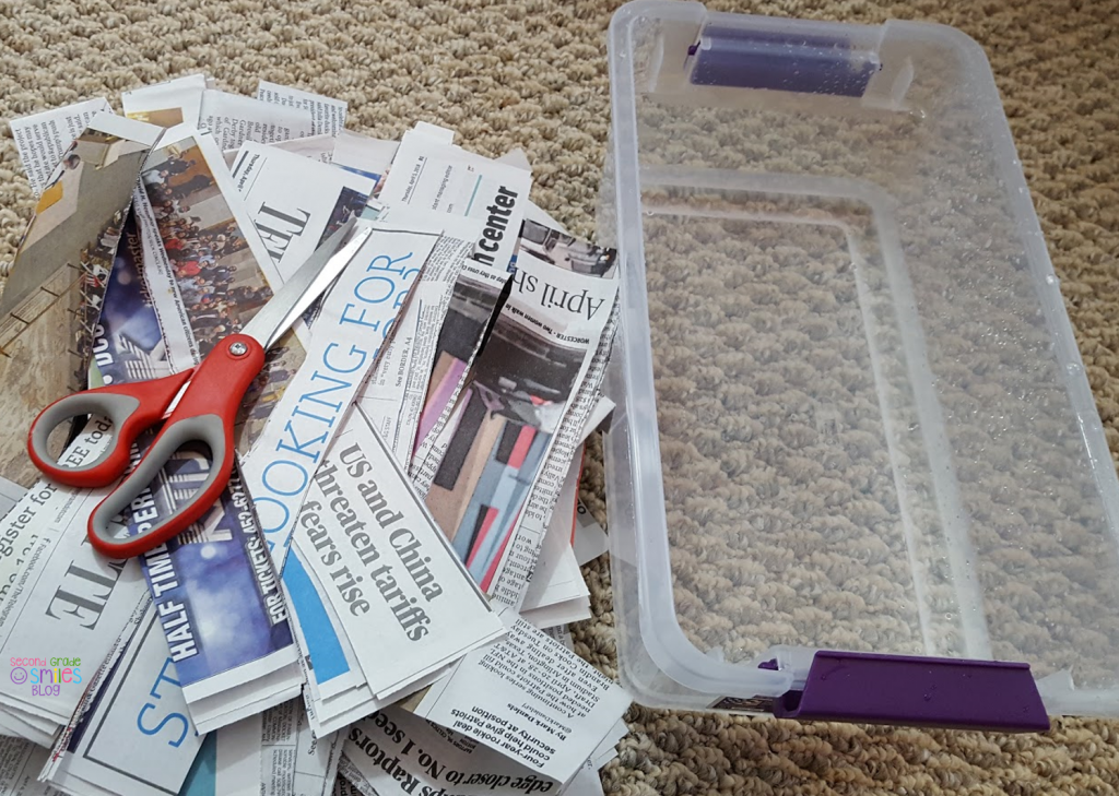 worm composting materials: newspaper, plastic tote, scissors